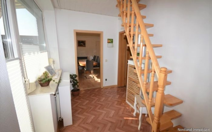 Holztreppe zum ausgebauten Dachboden