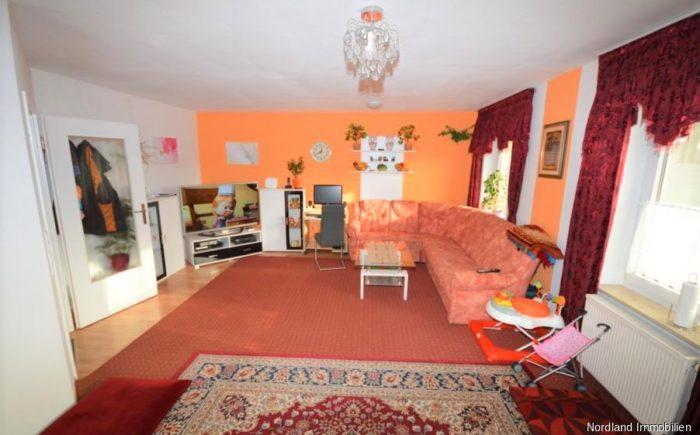 Wohnzimmer in der Obergeschosswohnung