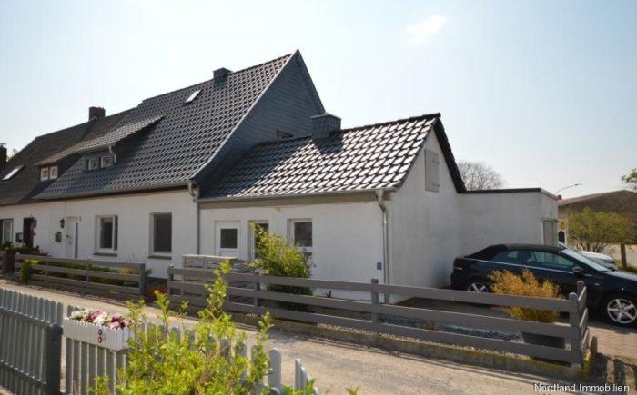 Doppelhaushälfte mit Garage und zwei PKW-Stellplätze